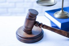 Wooden gavel, scales of justice and books. On table, closeup. Law concept royalty free stock image