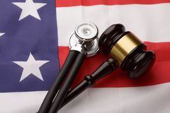 Wooden Gavel And Stethoscope On Usa Flag Stock Image