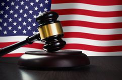Wooden gavel with USA flag in background Royalty Free Stock Image