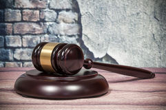 Wooden gavel on a vintage wall background Royalty Free Stock Photo