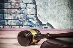 Wooden gavel on a vintage wall background Stock Images