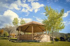Wooden gazebo against the sky stock image