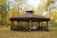 Wooden gazebo in autumn parks - relax and unwind Stock Image