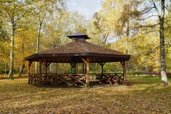 Wooden gazebo in autumn parks - relax and unwind Royalty Free Stock Photo