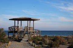 Wooden gazebo on the beach royalty free stock photo