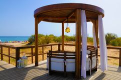 Beach Wooden Gazebo, Summer Holidays, Travel Portugal, Wood Canopy. Wooden gazebo at beach with view over the sea, Algarve, Portugal stock images