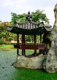 Wooden gazebo in the Chinese garden stock images