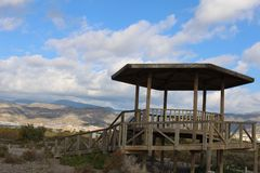 Wooden gazebo and cloudy sky stock image
