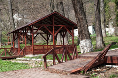 Wooden gazebo in the forest for relaxing Stock Photo