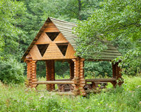 Wooden Gazebo in forest Royalty Free Stock Images