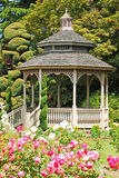 Wooden gazebo in garden Stock Images