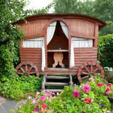 Wooden Gazebo in garden stock photography