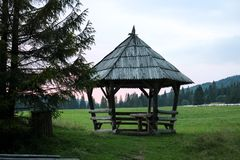 Wooden gazebo in the mountains stock photos