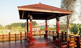 Landscaping gazebo pavilion in park. Wooden gazebo, pavilion, terrace on outdoor wood deck in landscaping park Stock Photography