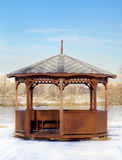 Wooden gazebo in park moscow. Wooden gazebo in winter park moscow Stock Images