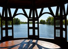 Wooden gazebo on the river bank. For your design Stock Images