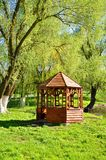 Wooden gazebo on the river bank. For your design Royalty Free Stock Photo