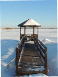 Wooden gazebo by the river at winter. Stock Image
