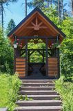 Wooden gazebo with stairs and flowers. In the summer park Royalty Free Stock Photo