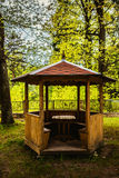 Wooden gazebo. A wooden gazebo in summer city park Royalty Free Stock Photo