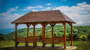 Wooden gazebo. A wooden gazebo in summer city park Stock Image