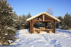 Wooden gazebo in winter forest. Royalty Free Stock Photo