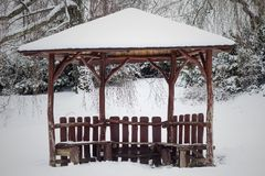 Wooden gazebo in the woods intended for outdoor recreation. Wonderful nature. Place for leisure travelers. Royalty Free Stock Image