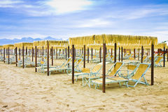 Wooden gazebos in a italian coastline Royalty Free Stock Photography