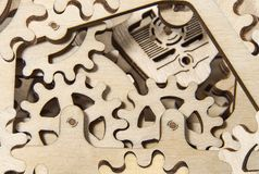Wooden gear mechanism close up. Wooden gearwheels close up. Mechanisms and devices stock photos