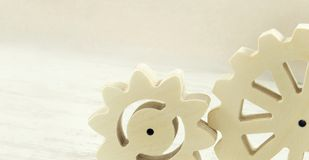 Wooden gear mechanism on a white background. Technologies wood creative Stock Photo