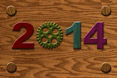 2014 Wooden Gear on Wood Grain Texture Background Royalty Free Stock Photos