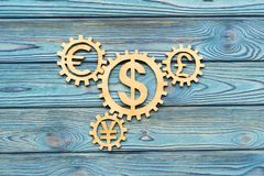 Wooden gears with dollar currency signs. Euro on wooden background. business. finance vector illustration