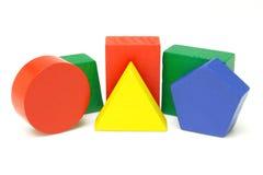 Wooden geometric blocks. Colorful wooden geometric blocks on white background Royalty Free Stock Photo