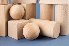 Wooden geometric shapes on a blue Royalty Free Stock Image