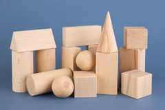 Wooden geometric shapes on a blue Royalty Free Stock Photography