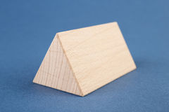 Wooden geometric shapes on a blue Stock Image