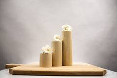 Wooden geometrical pieces with white roses Royalty Free Stock Photos