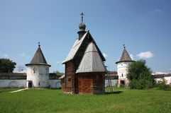 The wooden George Church and the tower in the Monastery of Archangel Michael. Russia. The wooden George Church (18th century) and the tower in the Monastery of royalty free stock photos