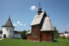 The wooden George Church and the tower in the Monastery of Archangel Michael. Russia. The wooden George Church (18th century) and the tower in the Monastery of royalty free stock image