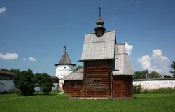 The wooden George Church and the tower in the Monastery of Archangel Michael. Russia. The wooden George Church (18th century) and the tower in the Monastery of royalty free stock photography