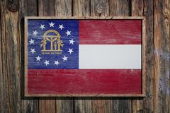 Wooden Georgia flag. 3d rendering of a Georgia State USA flag on a wooden frame and a wood wall Royalty Free Stock Images