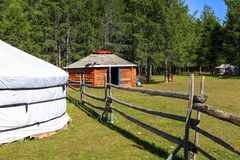 A wooden ger in Mongolia. A traditional yurt (from Turkic) or ger (Mongolian) is a portable, round tent covered with skins or felt used as a dwelling by nomads Royalty Free Stock Images