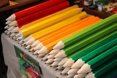Wooden giant pencils. On a market table royalty free stock image