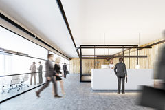 Wooden and glass office, a white reception, people Stock Photo