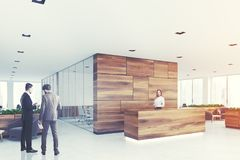 Wooden and glass reception, armchairs, side, men Stock Photography
