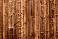 Wooden gnarly background. Brown and gnarly wooden background Royalty Free Stock Photography