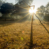Wooden Goal on Field and Sunbeam in Morning Stock Photo