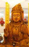 Wooden goddess of mercy (Guan Yin) statue Stock Images