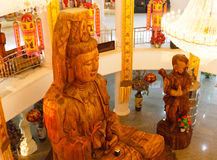 Wooden goddess of mercy (Guan Yin) statue. In asian temple Stock Image