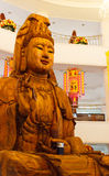 Wooden goddess of mercy (Guan Yin) statue. In asian temple Royalty Free Stock Images